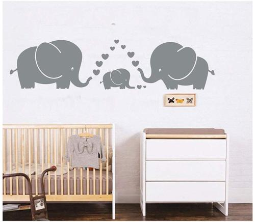 three cute elephants parents and kid family